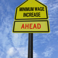 Sign that reads minimum wage