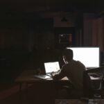 Businessman working overtime at his desk late at night